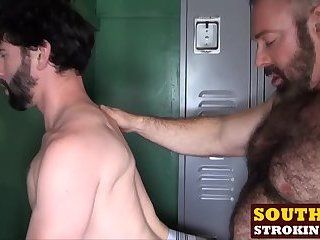 Sexy brunette hunk getting fucked hard by two big bears