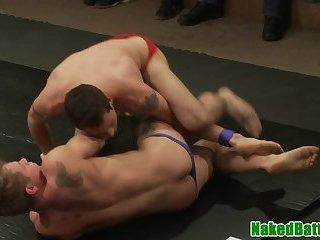 Wrestling hunks masturbating in foursome