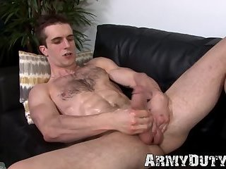 Handsome army jock grabs his hairy dick and strokes it solo